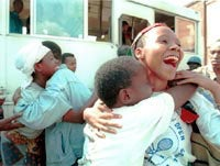 A Rwandan woman reunited with her brother.