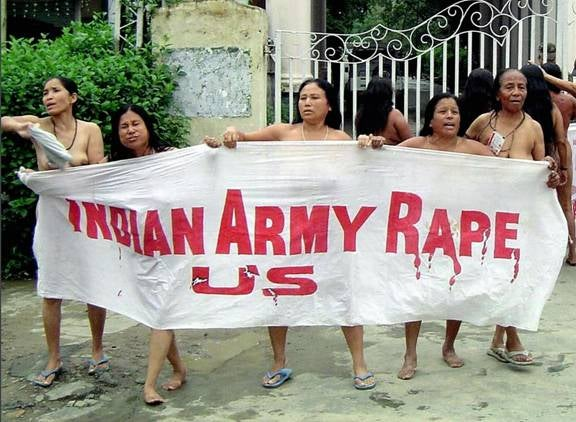 """Women protest the killing and alleged rape of Thangjam Manorama Devi with a banner reading """"Indian Army Rape Us"""" at the army headquarters in Imphal in July 2004. © 2004 AFP/Getty Images"""