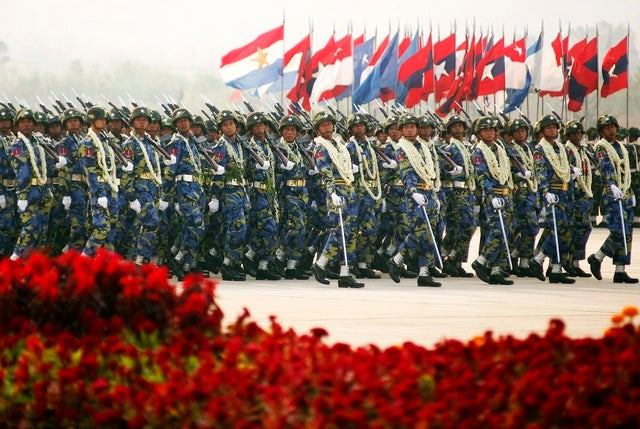 Burma's soldiers carry their weapons as they march during the Armed Forces Day parade in Burma's capital Naypyidaw on March 27, 2010.