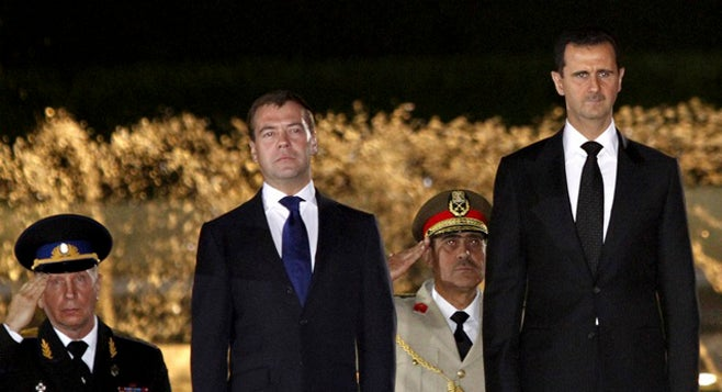Syrias President Bashar al-Assad (R) and Russias President Dmitry Medvedev review the honor guards at al-Shaaeb presidential palace in Damascus, Syria on May 10, 2010. (Photo courtesy of Reuters)