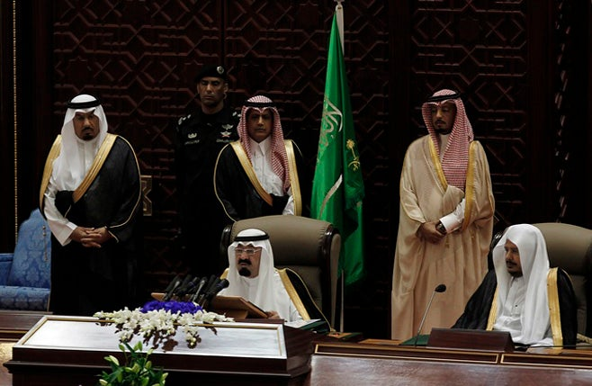 King Abdullah of Saudi Arabia (center, seated) addressed the advisory Majils Al-Shura Sunday, announcing that women would have the right to vote in 2015s municipal elections. (Photo courtesy of Reuters)