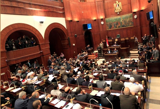 <p>Members of Egypt's constitution committee meet at the Shura Council for the final vote on a draft Egyptian constitution in Cairo.</p>