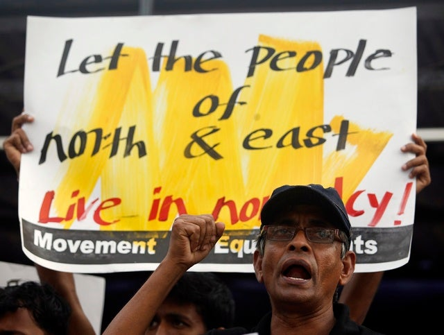 <p>A member of an equal rights movement shouts slogans during a protest against the government in Colombo on December 18, 2012.</p>
