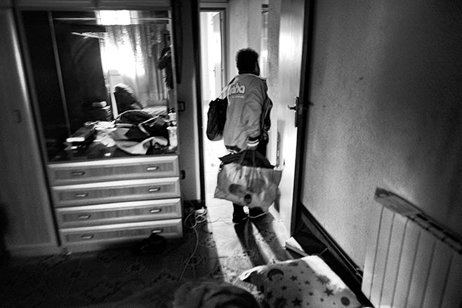 <p>A woman picks up her clothes from her room after receiving an eviction notice in Terrassa, Spain, October 19, 2012.</p>