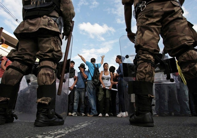 Demonstrators face riot police during one of the many protests around in Belo Horizonte, Brazil on June 17, 2013.