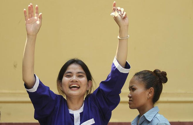 <p><p>Boeung Kak Lake resident Yorm Bopha (C) reacts after she was denied bail at a hearing in the Supreme Court in the capital city of Phnom Penh on March 27, 2013.</p></p>