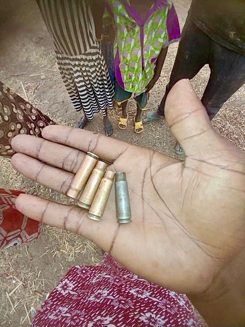 A man displays bullet casings on his palm