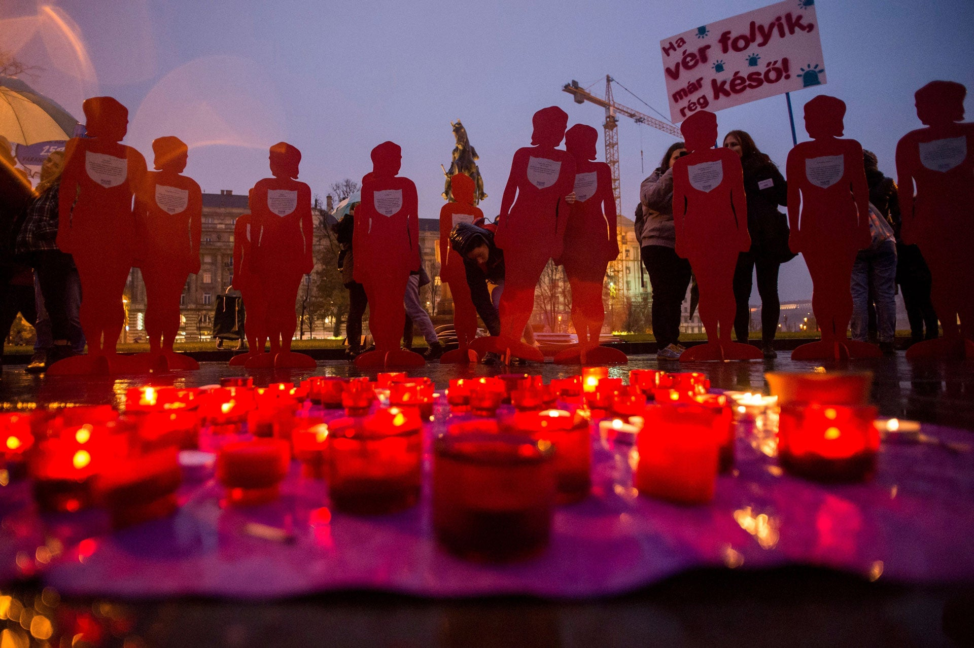 Candles and silhouettes representing victims are placed during a rally to mark the International Day for the Elimination of Violence Against Women outside the Parliament in Budapest, Hungary, November 25, 2018.