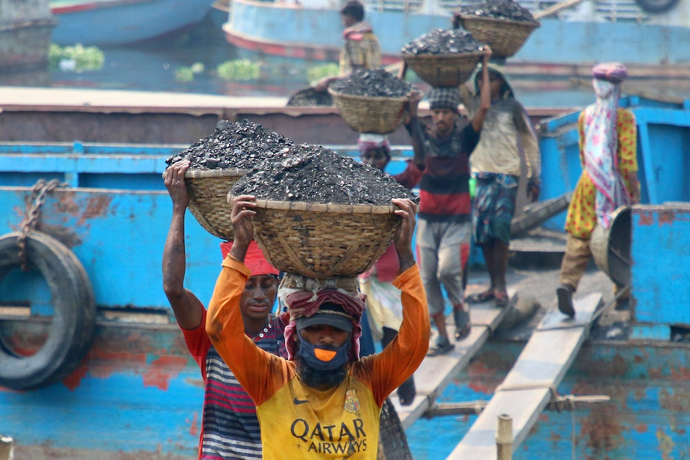 Men working in a coal mine in Bangladesh