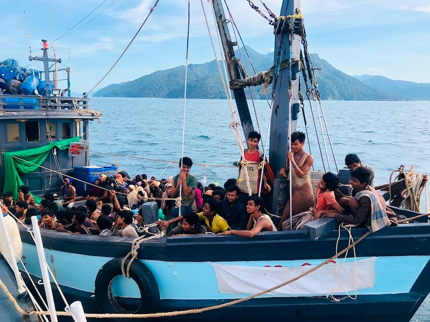 A boat carries Rohingya refugees off the coast of Langkawi, Malaysia, April 5, 2020.