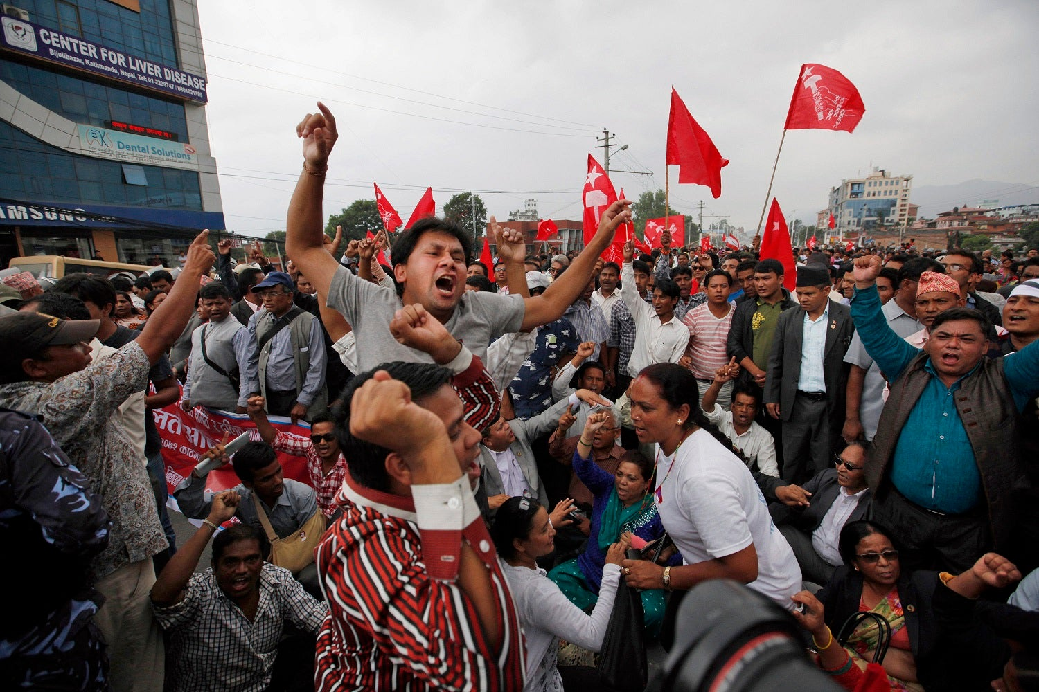 Nepalese activists of the Dalit community, also known as the untouchables, shout slogans during a protest near the Nepalese Constituent Assembly Hall in Kathmandu, Nepal, Wednesday, Aug. 5, 2015.  © 2015 AP Photo/Niranjan Shrestha