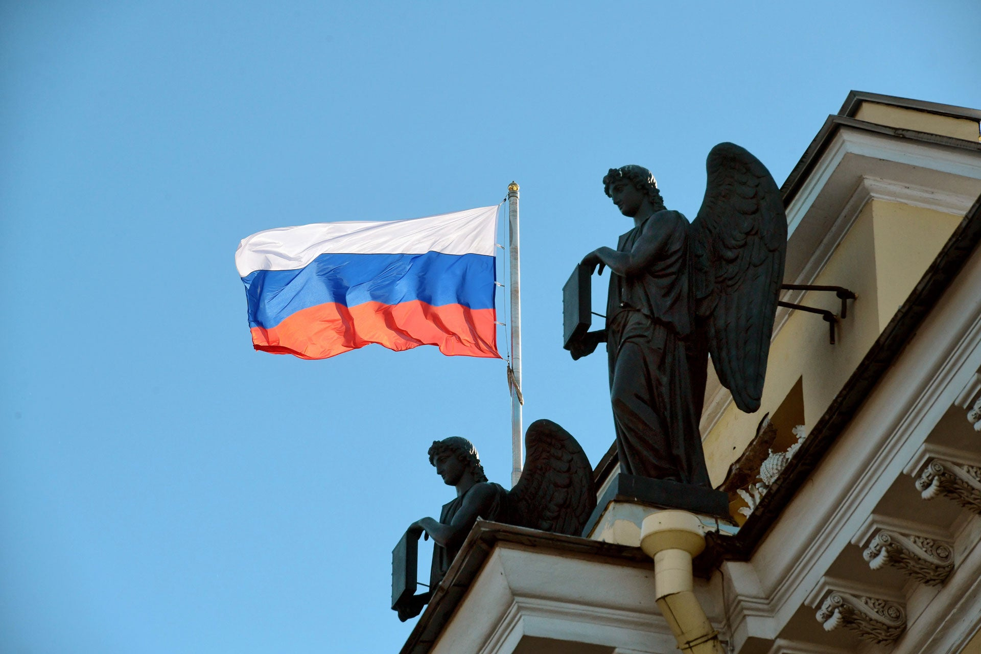 The Russian flag flies on a courthouse building in St. Petersburg, Russia, March 15 2020.