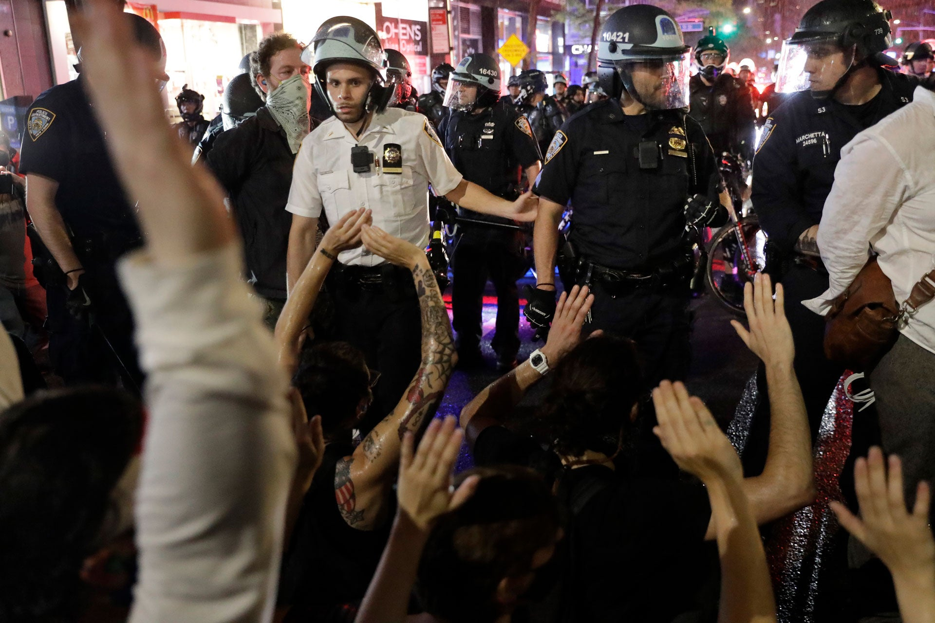 Police arrest protesters as they march through the streets of Manhattan, New York, Wednesday, June 3, 2020.