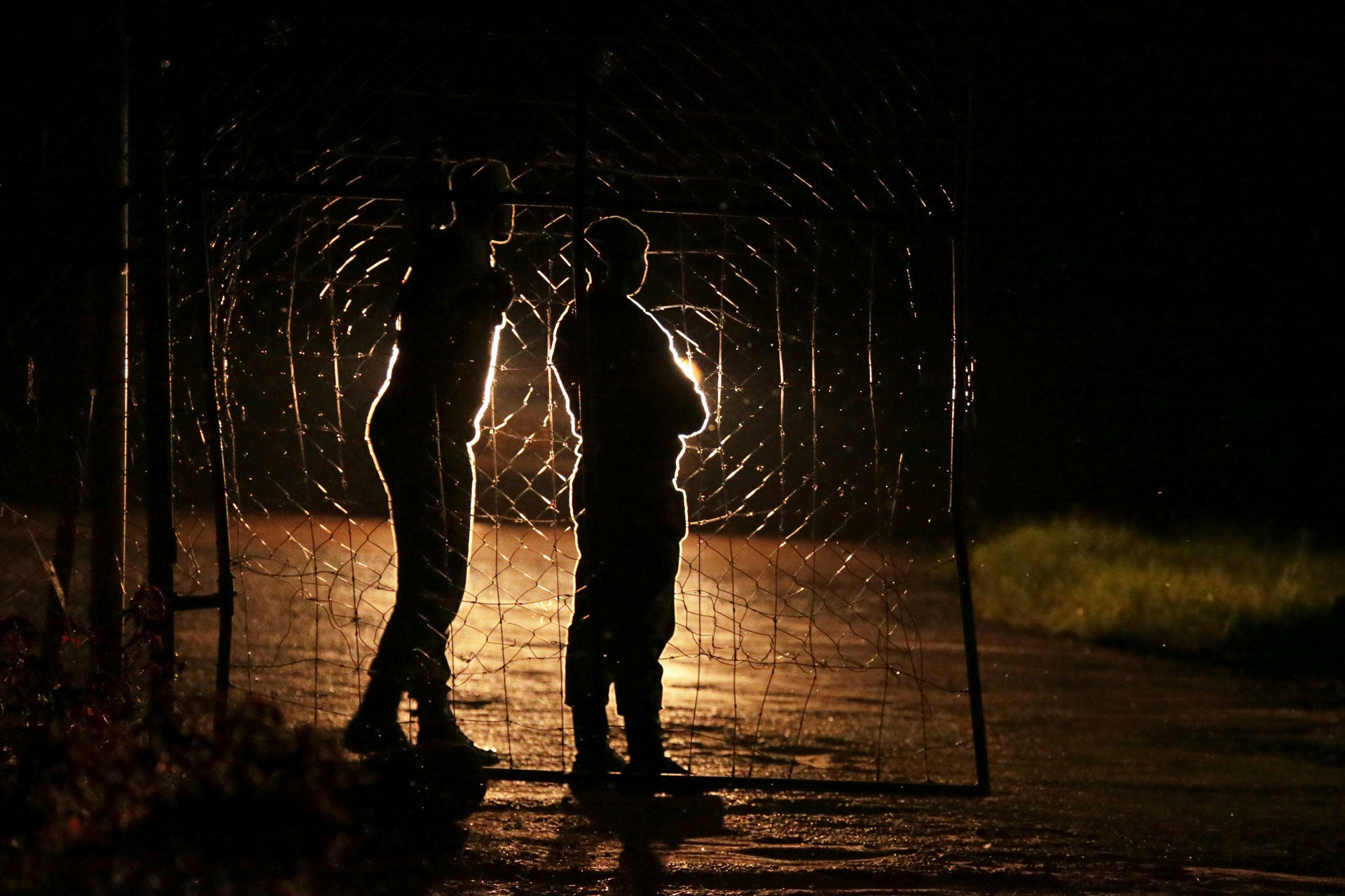 Armed Zimbabwean prison guards are seen at the entrance of Chikurubi prison on the outskirts of Harare, January 30, 2019.