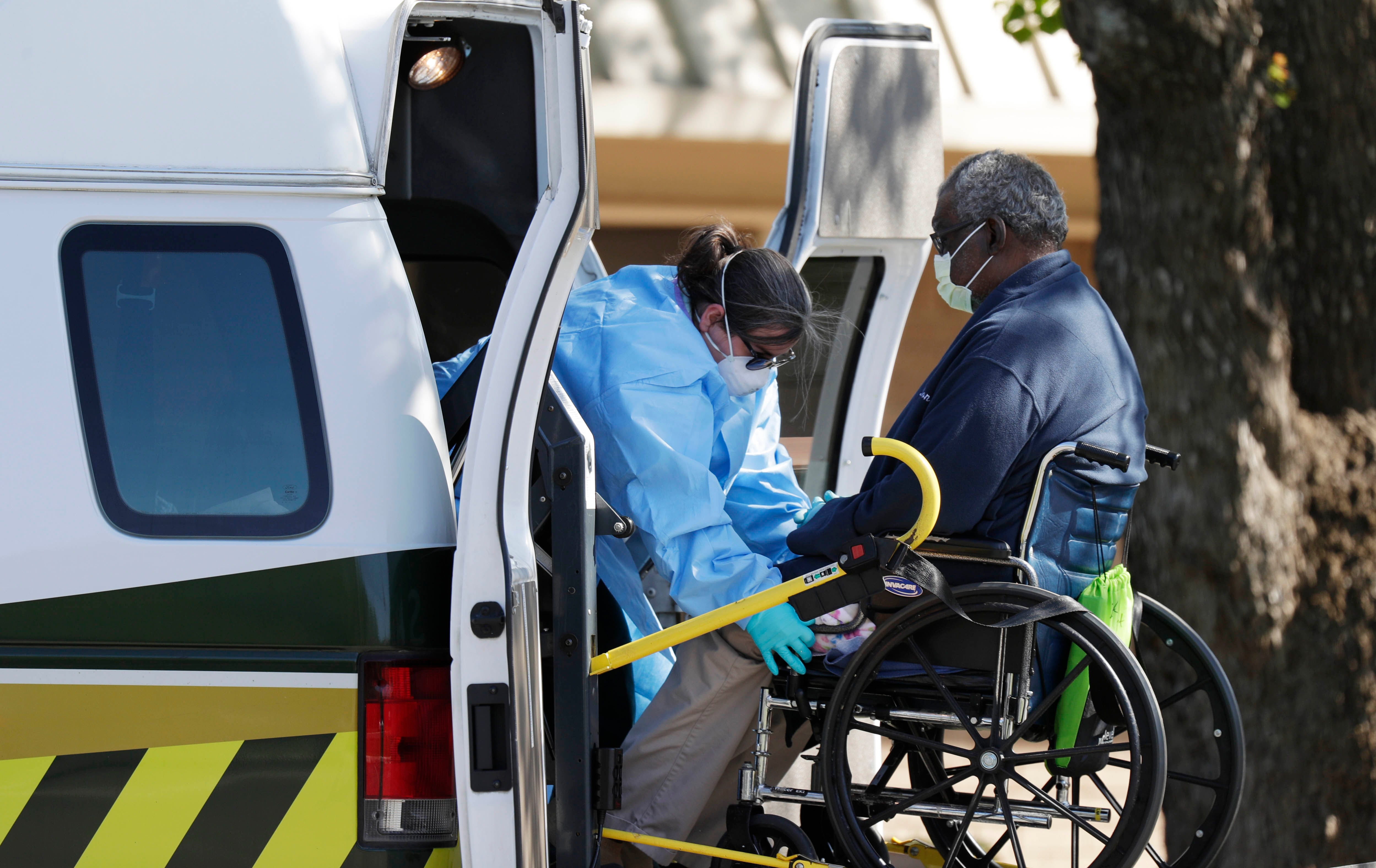 A resident of a nursing home is loaded into an ambulance in Texas.