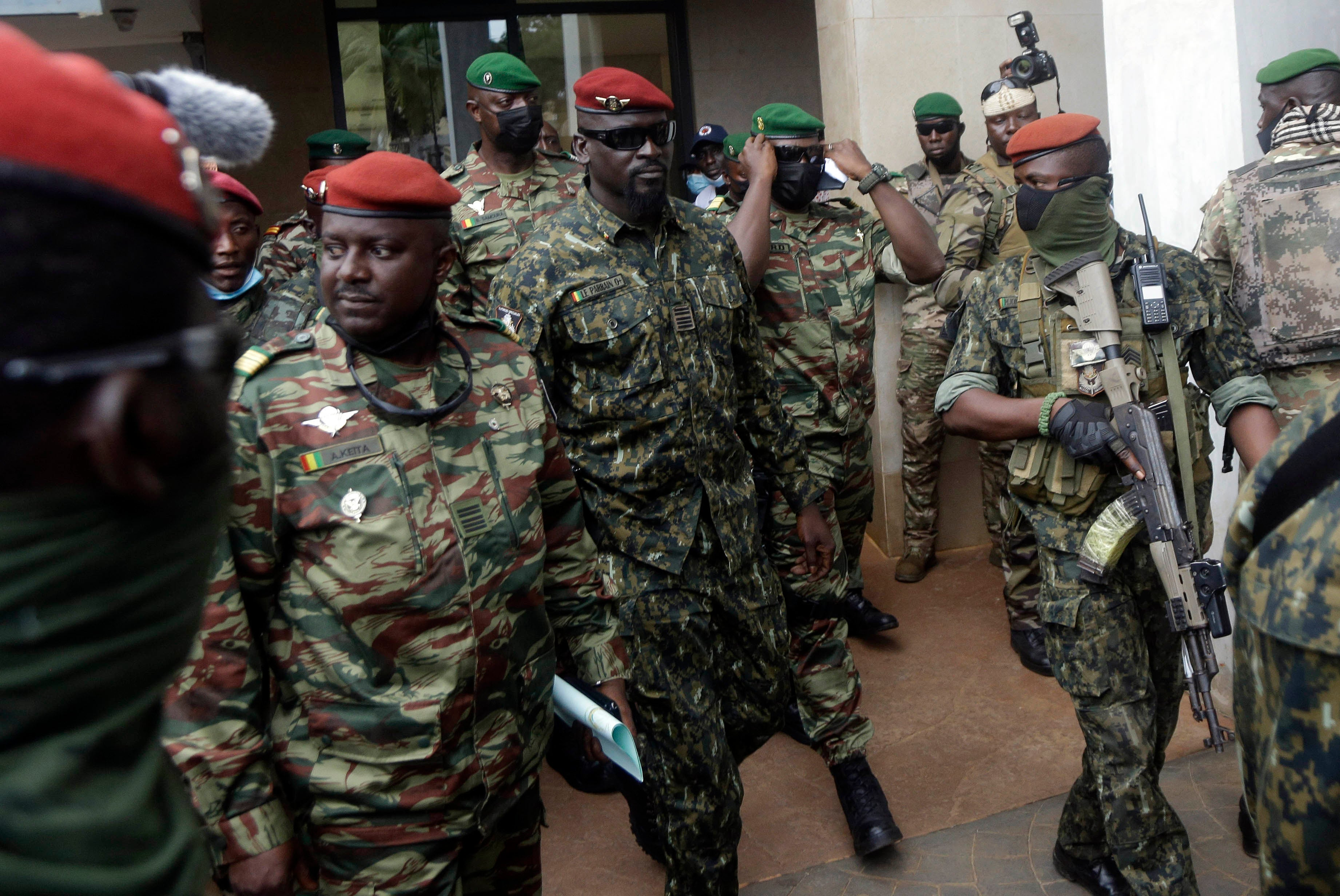 Guinea's Col. Mamady Doumbouya, center, is heavily guarded by soldiers after a meeting with ECOWAS delegation in Conakry, Guinea on September 10, 2021.