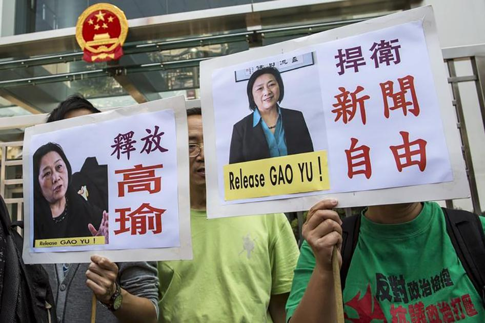 Pro-democracy protesters in Hong Kong hold up signs during a demonstration calling for the release of Chinese journalist Gao Yu on April 17, 2015.