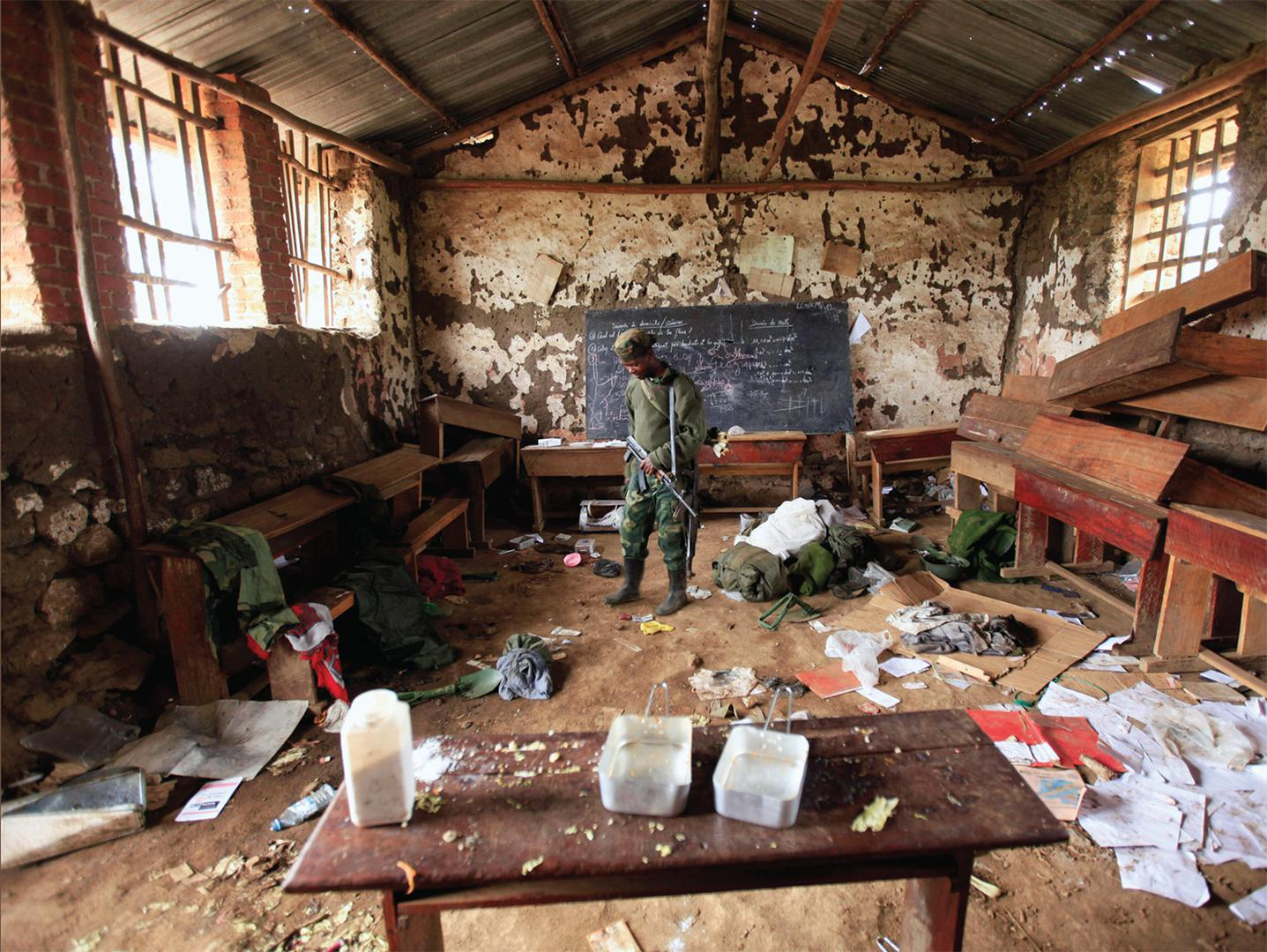 Congolese rebel fighter abandoned classroom