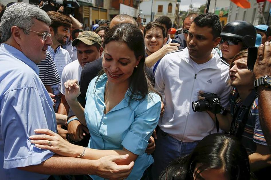 Venezuela's opposition leader Maria Corina Machado greets supporters, after trying to register her candidacy for the upcoming parliamentary elections at an office of National Electoral Council, in Los Teques, Venezuela on August 3, 2015.