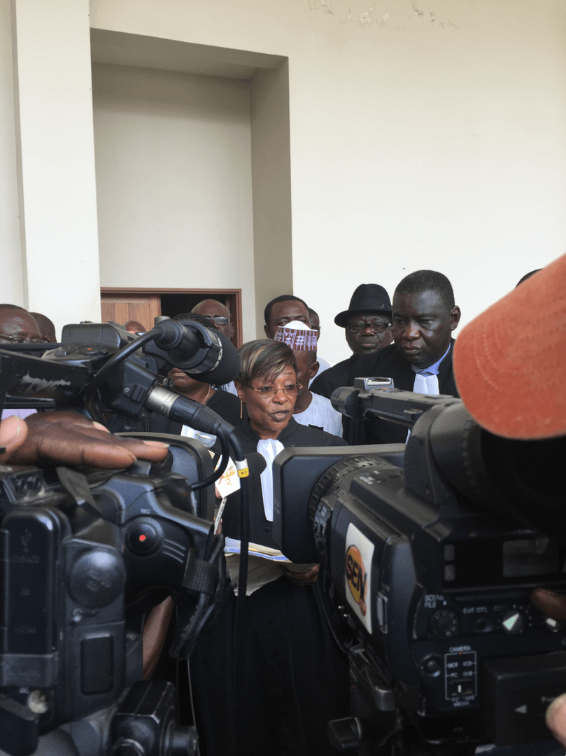 Jacqueline Moudeina speaking to reporters after the reading of the charges