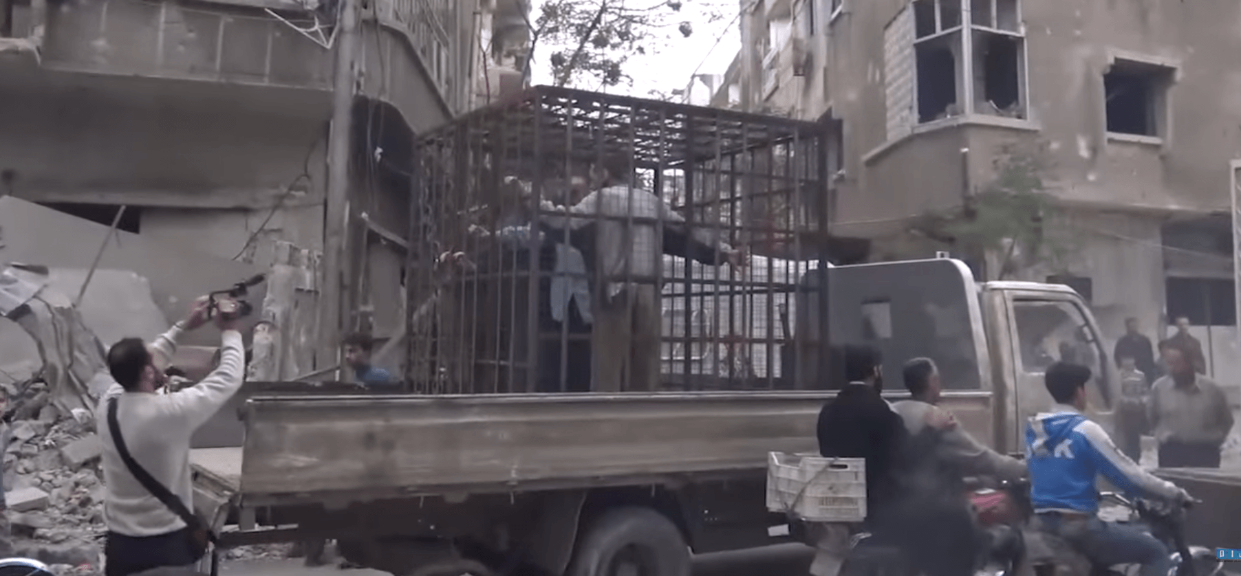 Still from video showing caged civilians in Eastern Ghouta, Syria. Courtesy of Sham News Network Youtube.