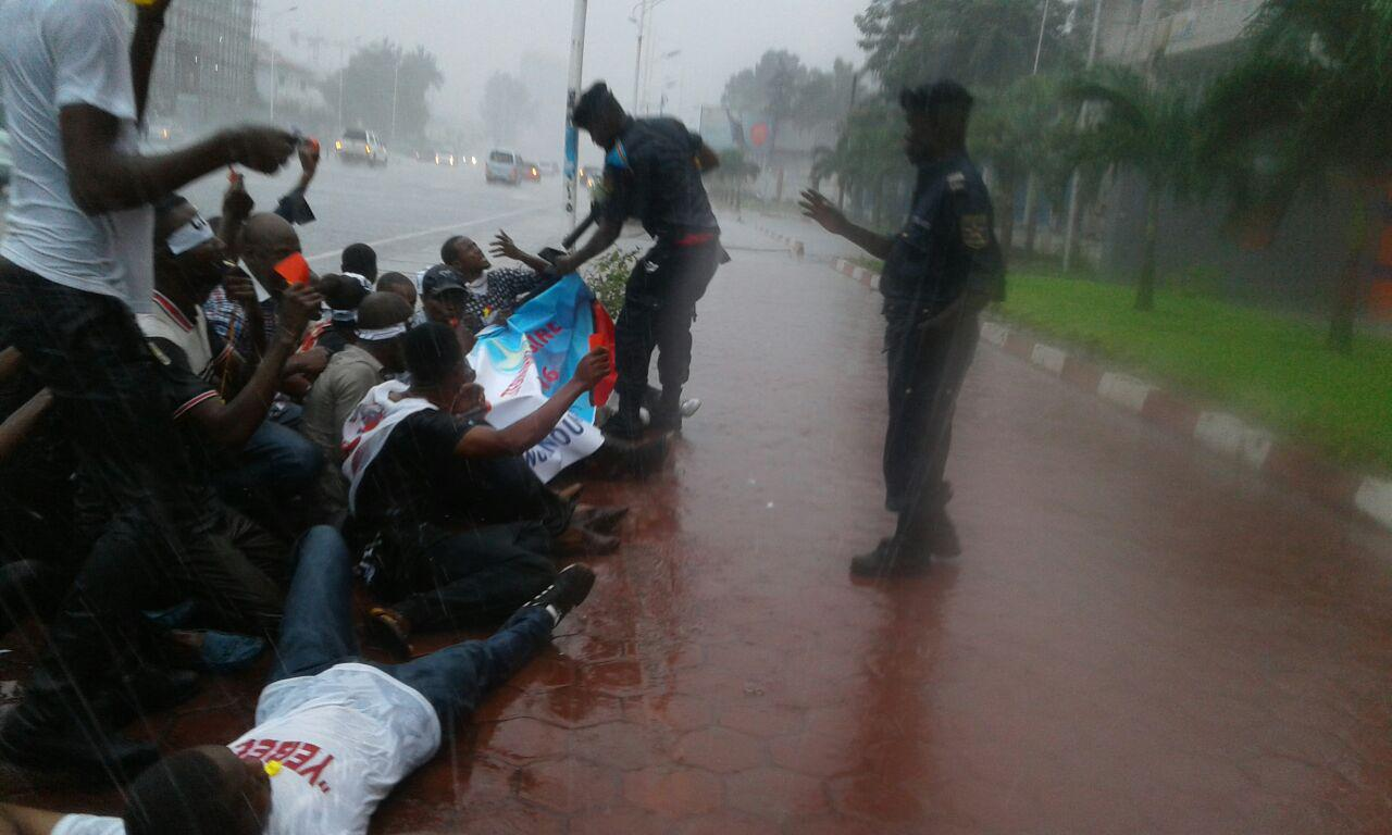 Police detain members of the youth movement Filimbi after a peaceful sit-in outside the African Union (AU) office in Kinshasa on October 29, 2016.
