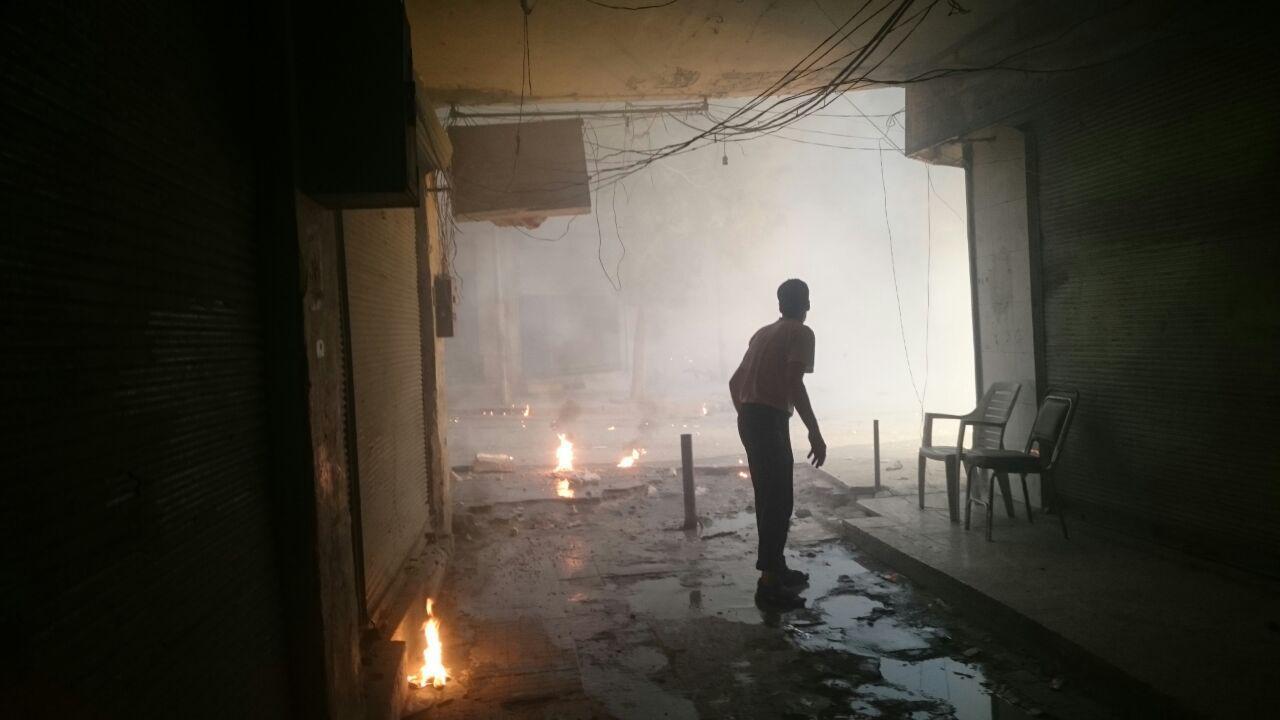 Последствия сброса зажигательной бомбы в районе Аш-Шаар 30 сентября 2016 г.