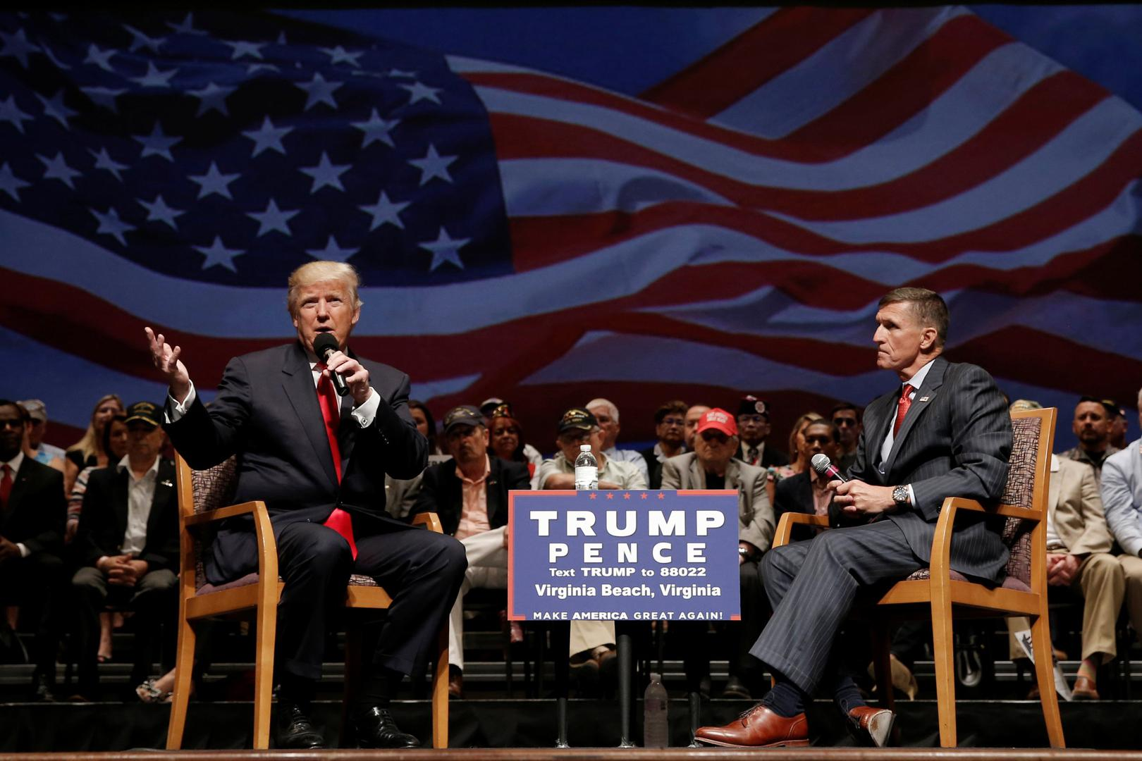 Donald Trump speaks alongside retired Lt. Gen. Mike Flynn during a campaign town hall meeting in Virginia, US, on September 6, 2016.