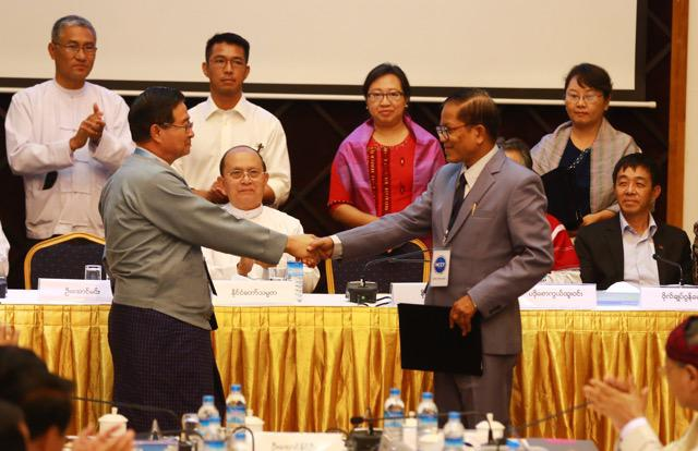 The signing of the draft Nationwide Ceasefire Agreement in Rangoon, March 31, 2015.