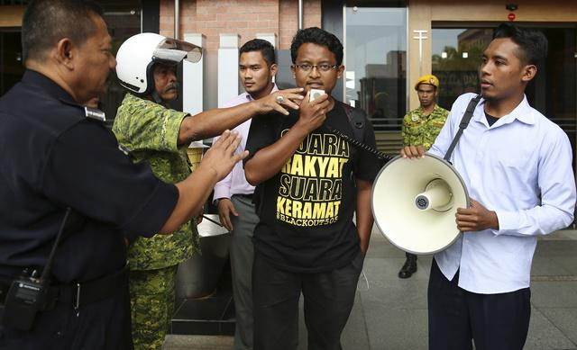 A university student leader calls for the repeal of the sedition act outside the Malaysian Ministry of Home Affairs building in Putrajaya on September 5, 2014.