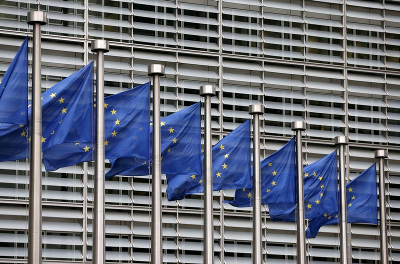 European Union flags flutter outside the EU Commission headquarters in Brussels, Belgium, October 28, 2015.
