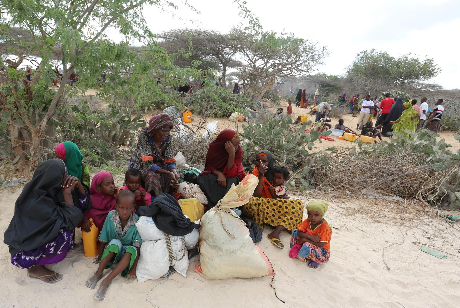 Somali families rest as they flee from drought-stricken Lower Shabelle region before entering makeshift camps in Somalia's capital, Mogadishu, joining the thousands already displaced, March 17, 2017. Al-Shabab forces attacked villages in Lower Shabelle re