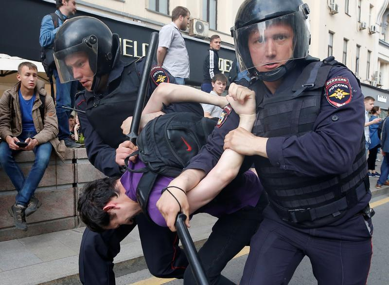 Riot police detain a man during an anti-corruption protest organised by opposition leader Alexei Navalny, on Tverskaya Street in central Moscow, Russia, June 12, 2017.