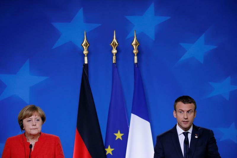 Die deutsche Bundeskanzlerin Angela Merkel und der französische Präsident Emmanuel Macron auf einer gemeinsamen Pressekonferenz auf dem EU-Gipfel in Brüssel, Belgien, 23. Juni 2017.