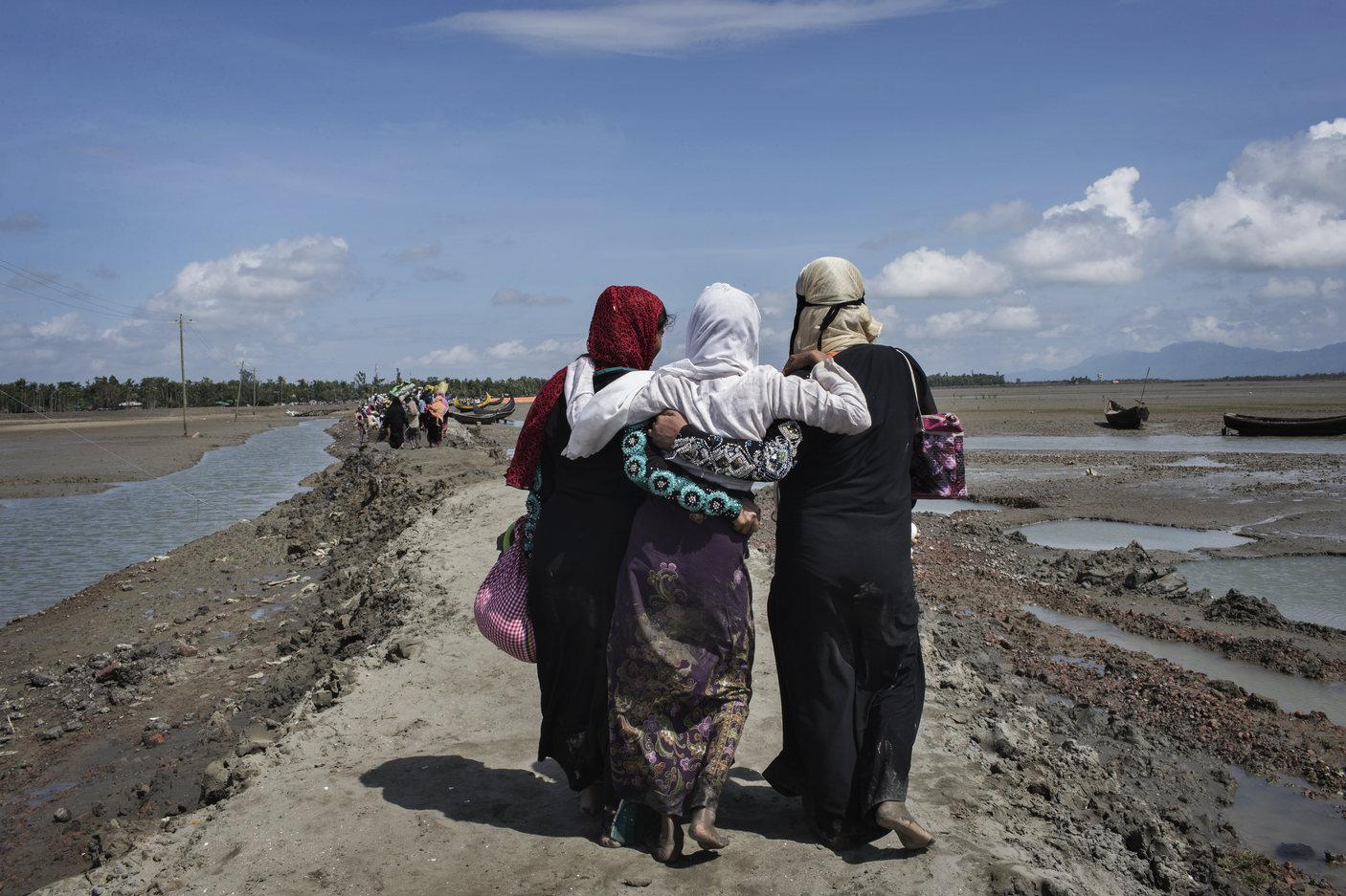 Rohingya women refugees who crossed the Naf River from Burma into Bangladesh continue inland toward refugee camps.