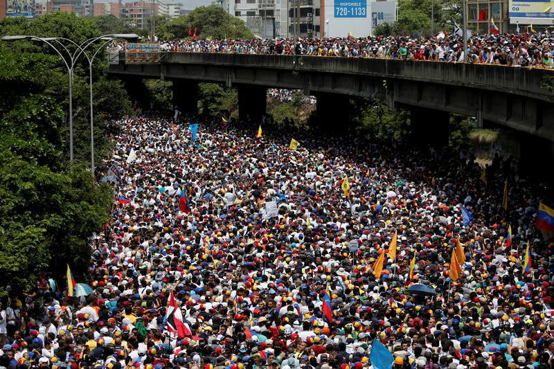 "Anti-government demonstrators march during the so-called ""mother of all marches"" in Caracas, Venezuela, April 19, 2017."
