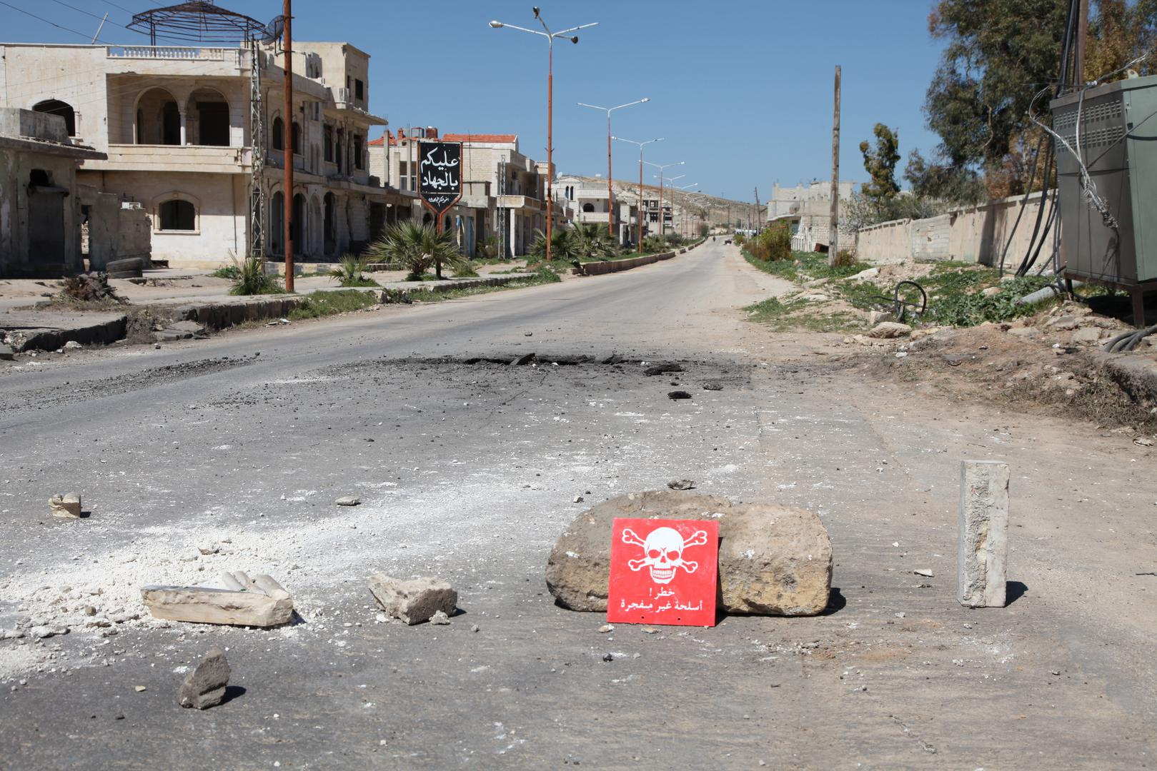 A poison hazard danger sign is seen in the town of Khan Sheikhoun, Idlib province, Syria on April 5, 2017.
