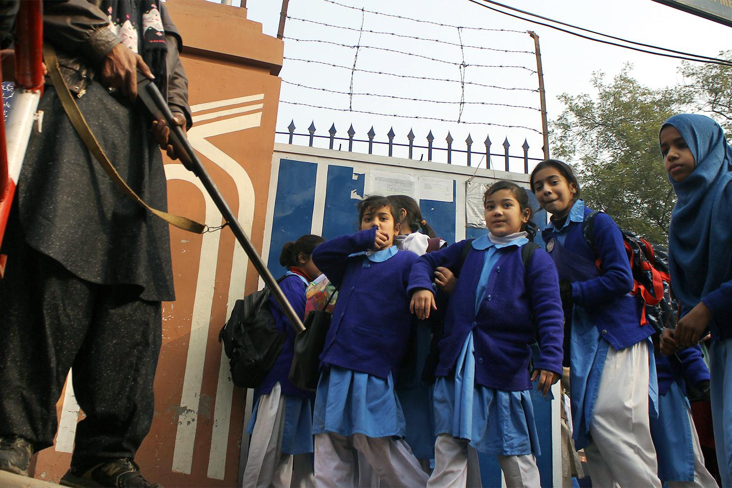 Pakistani students in Lahore return to school under high alert security after the December 16, 2014 attack by the Pakistani Taliban on the Army Public School in Peshawar, January 1, 2015.