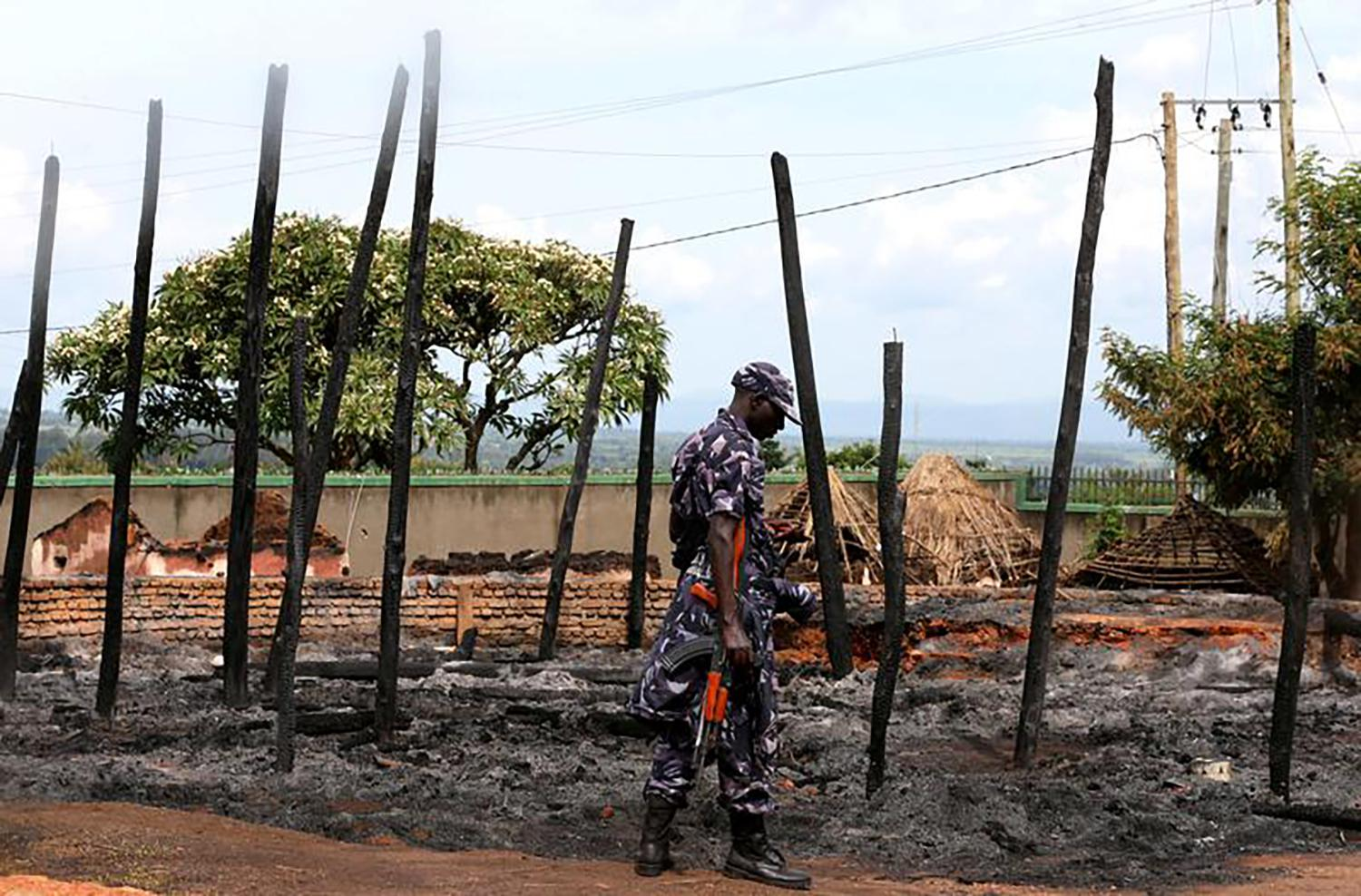 A Ugandan soldier guards the remains of the destroyed palace of Charles Wesley Mumbere, king of the Rwenzururu, after Uganda security forces stormed the compound in Kasese town, western Uganda on November 27. December 1, 2016.
