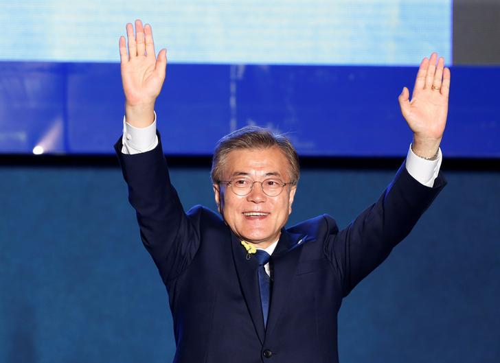 South Korea's president-elect Moon Jae-in celebrates at Gwanghwamun Square in Seoul, South Korea, May 9, 2017.
