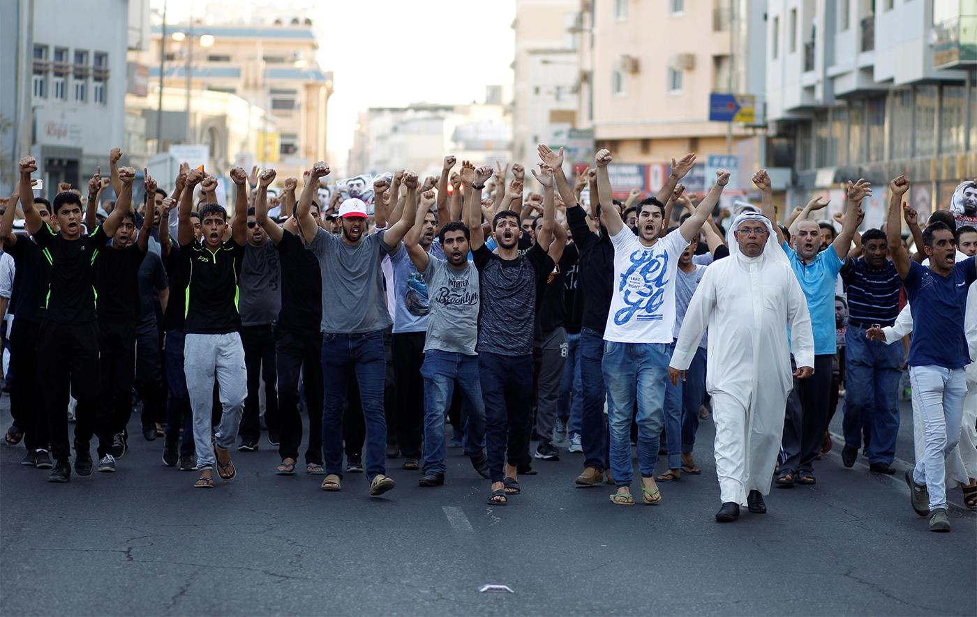 Mourners shouting anti-government slogans march during the funeral procession of Hassan Al Hayki, who died while in detention in Manama August 2, 2016.