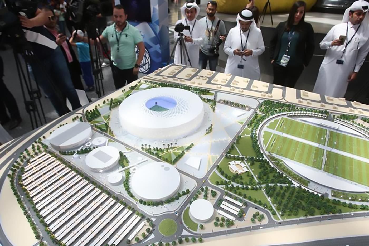 People look at a model of Al Thumama stadium during an unveiling ceremony at Hamad International Airport in Doha, Qatar, August 24, 2017. © 2017 REUTERS/Naseem Zeitoon