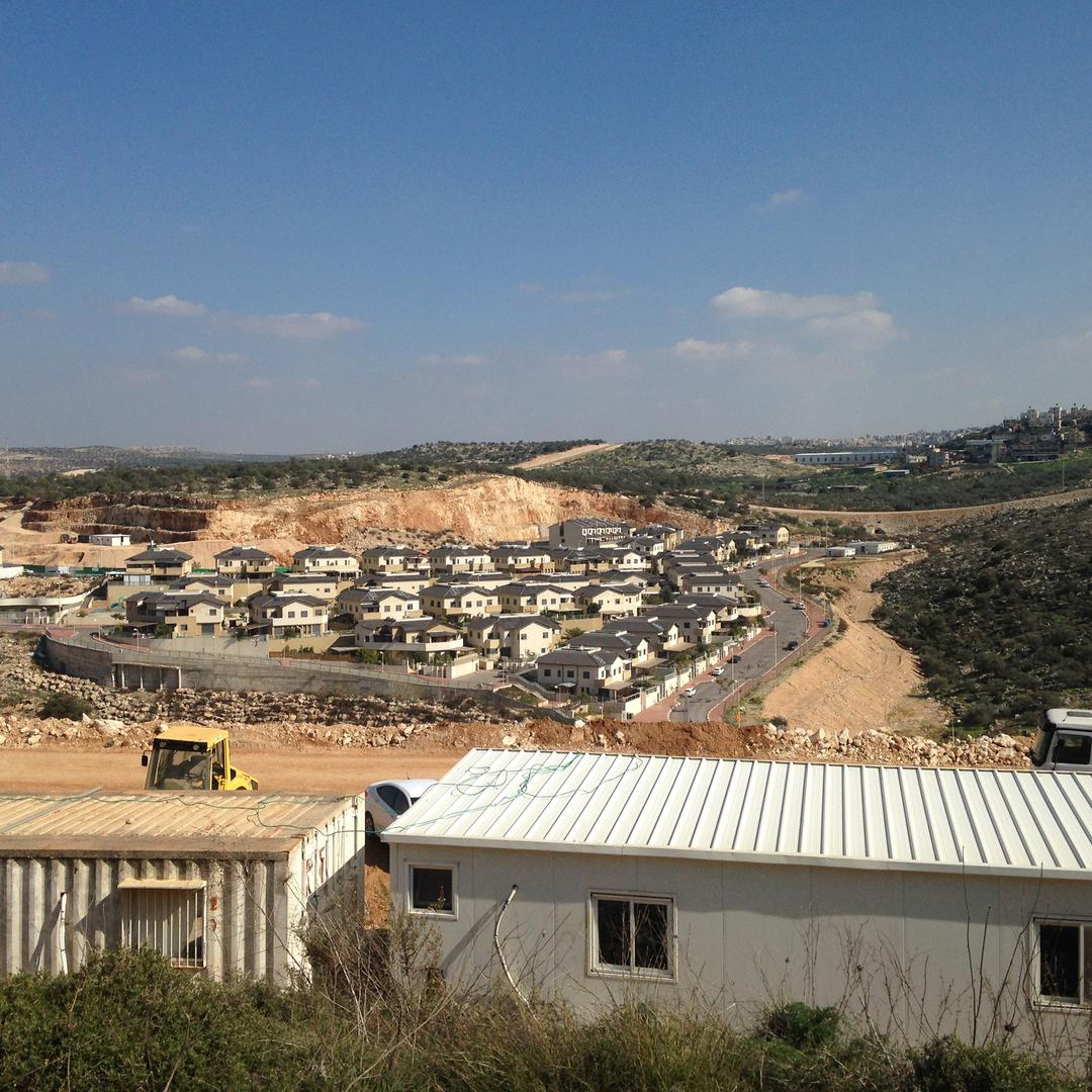Bulldozers clear land for construction of the Ahdut Elkana project in the Israeli settlement of Elkana.