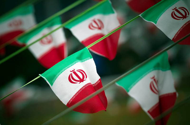 Iran's national flags are seen on a square in Tehran February 10, 2012.