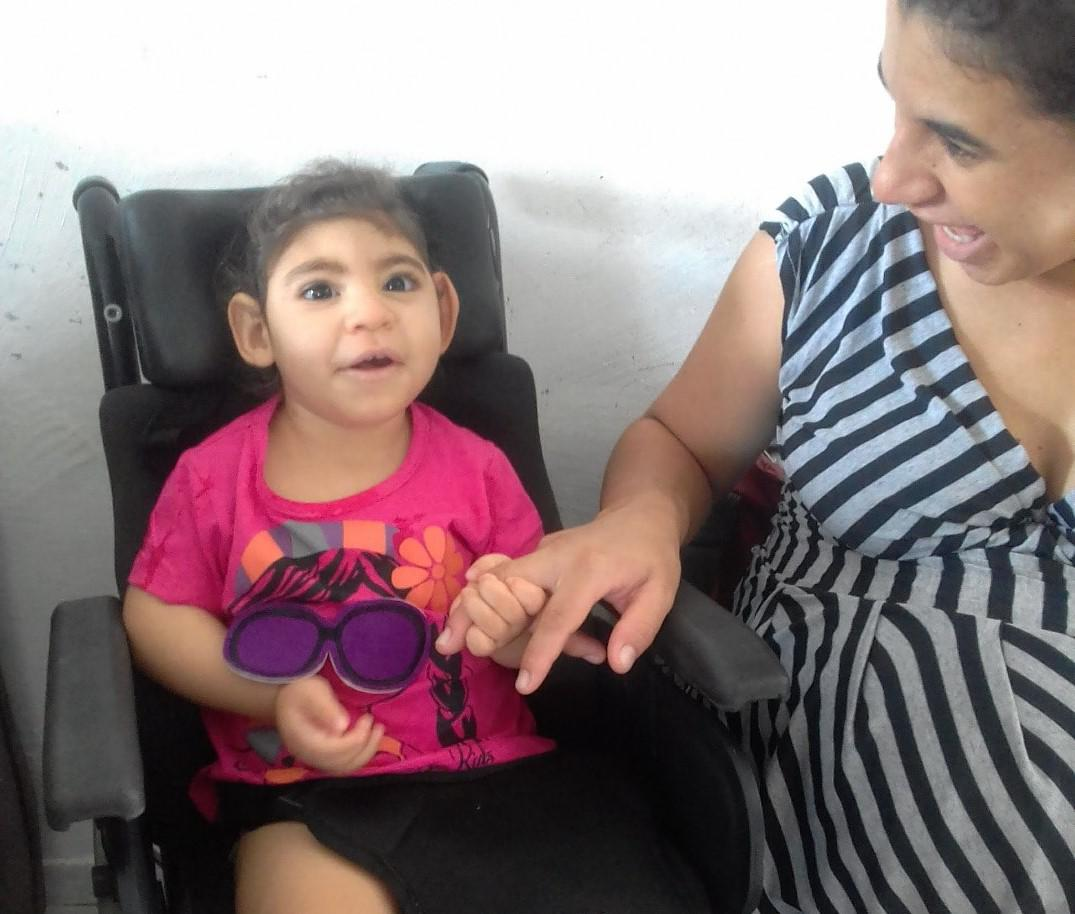 "Maria Gabriela Silva Alves (""Gabi""), age 2, with her mother, Maria Carolina Silva Flor (""Carol""), at their home in Esperança, Paraíba state, Brazil in 2018. Gabi was one of thousands of children born with disabilities caused by exposure to the Zika virus"