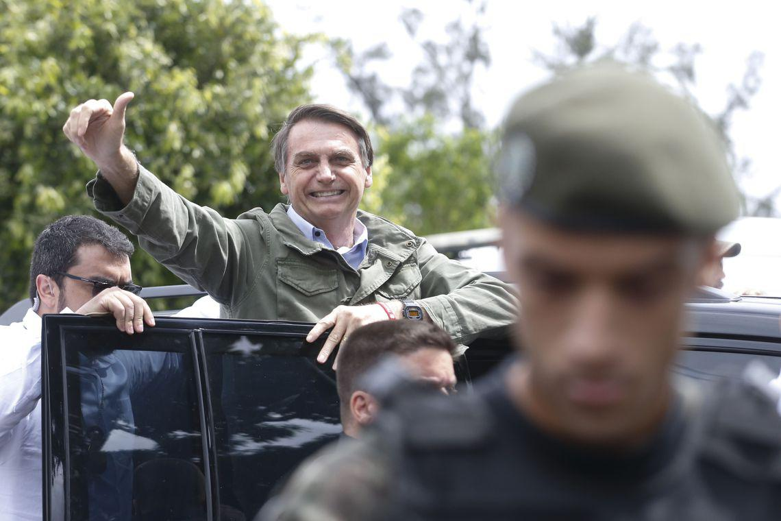 Protected by Federal Police agents, Social Liberal Party (PSL) presidential candidate Jair Bolsonaro votes on October 28 at the Rosa da Fonseca Municipal School in Rio de Janeiro, Brazil.