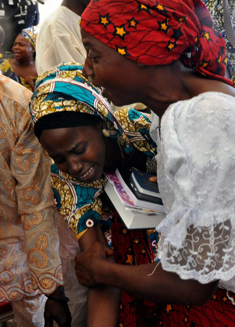One of the kidnapped Chibok girls celebrates with a family member following her release in Abuja, Nigeria, Sunday, Oct. 16, 2016.