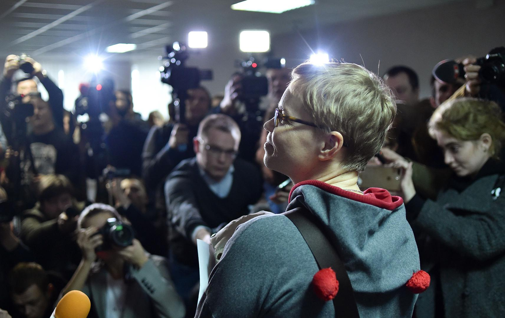 The media photograph Marina Zolotova, editor-in-chief of news portal tut.by, as she attends her trial for alleged 'unauthorised access' to information from state-run BelTA news agency, in Minsk, March 4, 2019. © 2019 SERGEI GAPON/AFP/Getty Images
