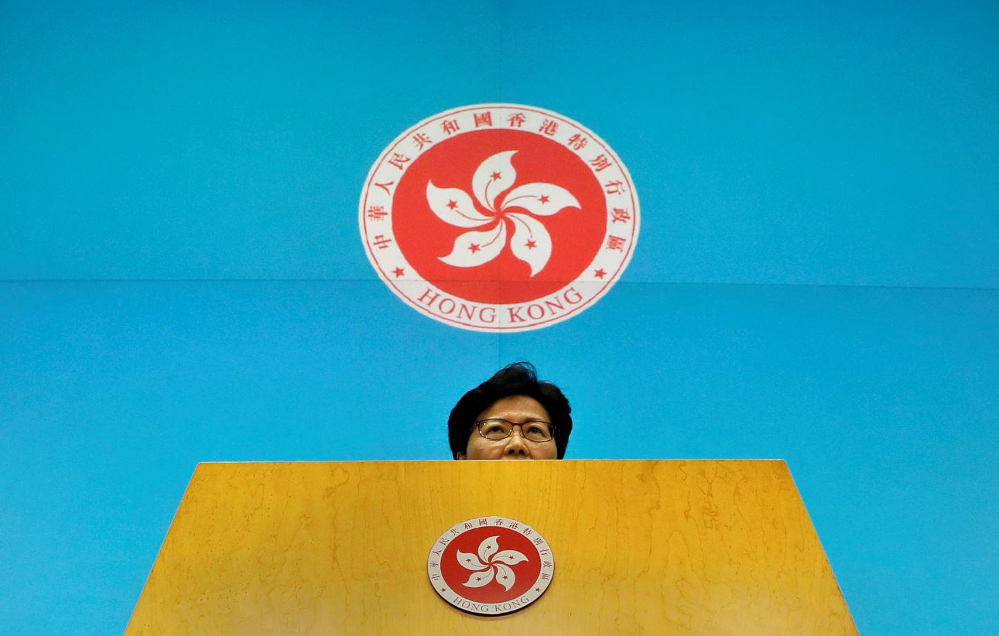 Hong Kong Chief Executive Carrie Lam listens to reporters' questions during a press conference at the Legislative Council in Hong Kong, Tuesday, June 18, 2019.