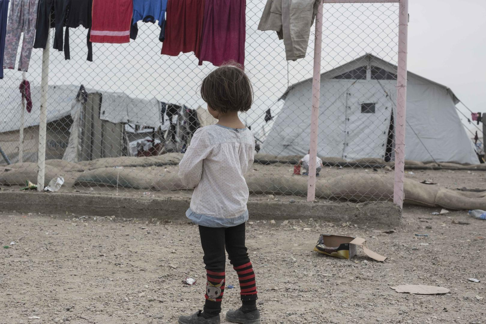A girl stands in the annex of al-Hol camp in northeast Syria, where more than 11,000 women and children from nearly 50 nationalities are confined as family members of Islamic State (also known as ISIS) suspects. The Kurdish-led coalition controlling north